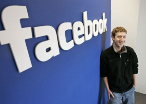 Mark Zuckerberg con logo di Facebook